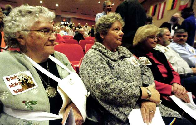 "Joan Griffith, left, and Laurie Lewis are among Southbury residents attending a showing of Scott Sniffins' film ""Home of the Brave"" in Southbury Sunday, Nov. 18, 2012. The event marks the 75th anniversary of residents saying no to a Nazi training camp in town. Griffith and Lewis wear badges that read ""My family said No to Nazis."" Photo: Michael Duffy"