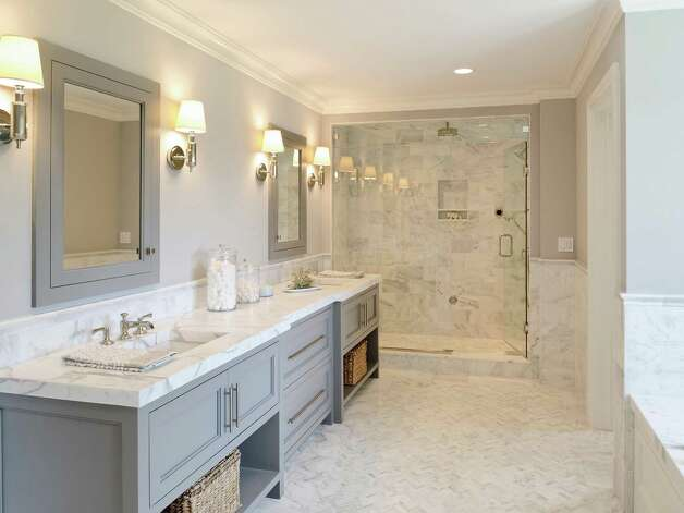 The master bath features heated marble floors, his and hers vanities, a steam shower and a spa bath. Photo: Contributed Photo/ Daniel Milste / All rights reserved