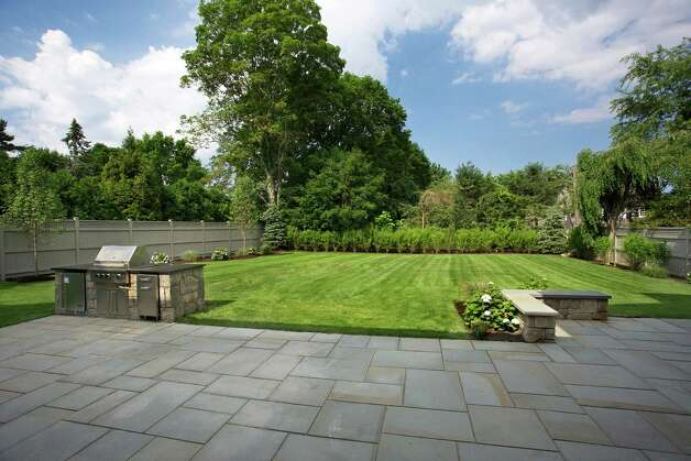 The level backyard, off the patio, offers room for a swimming pool. Photo: Contributed Photo/Daniel Milstei