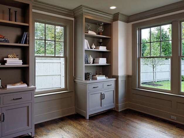 The privately sited library with built-ins and tray ceiling overlooks the property. Photo: Contributed Photo/ Daniel Milste / All rights reserved