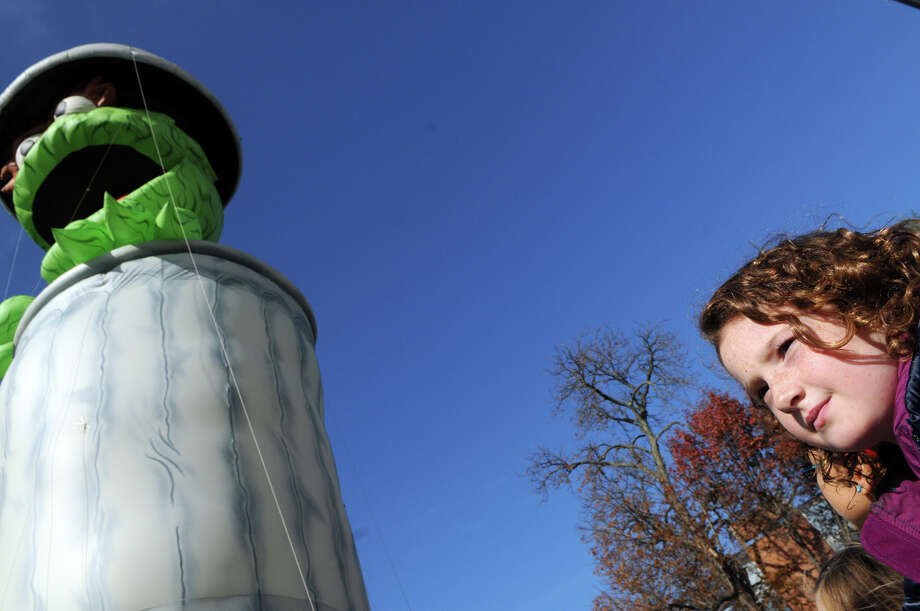 Laure Mirando, 9, watches as Oscar the Grouch passes by during he UBS Parade Spectacular in Stamford, Conn., Nov. 18, 2012. Photo: Keelin Daly / Stamford Advocate Freelance