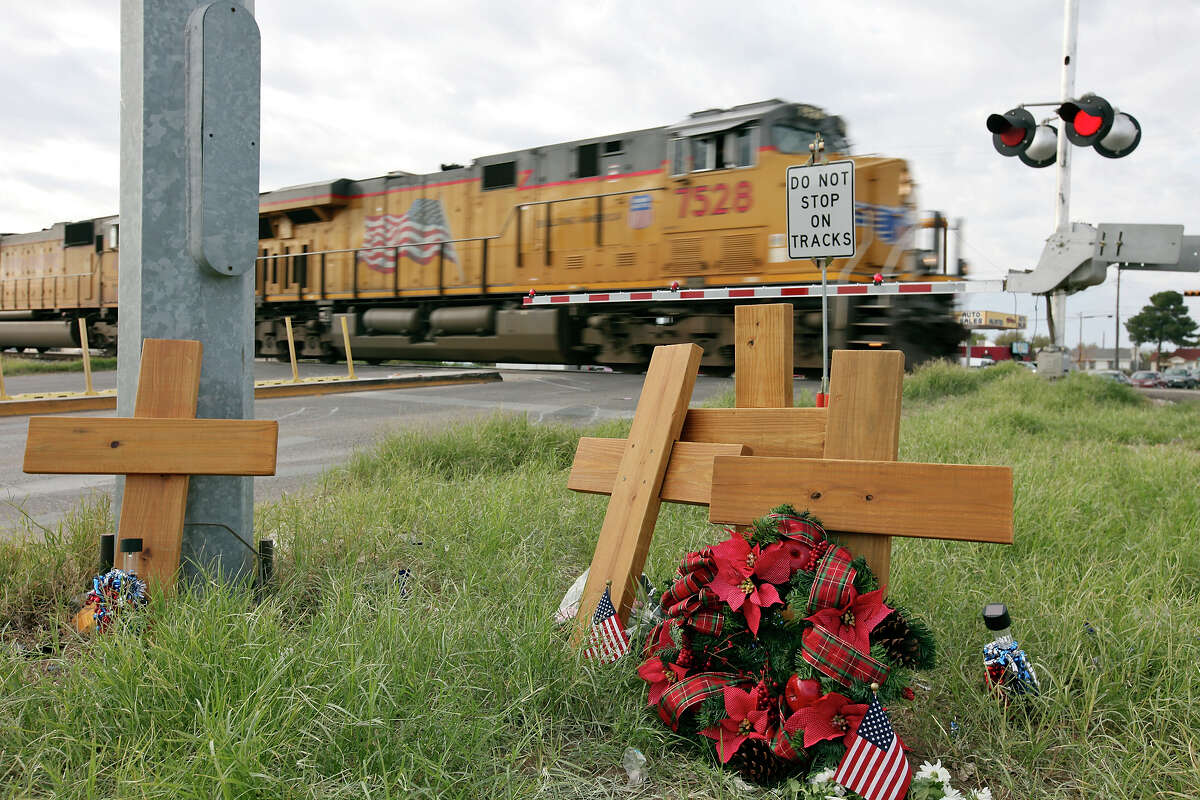 A Union Pacific train passes four crosses at the intersection, Sunday Nov. 18, 2012, in Midland, Tx., where a Union Pacific train struck a float carrying military veterans on Thursday Nov. 15, 2012, killing four men, including one from the San Antonio area.