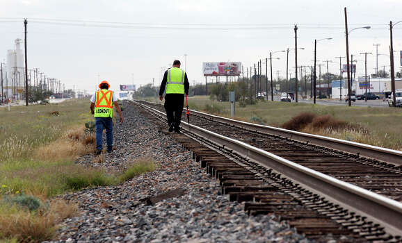 Workers inspect the intersection, Sunday Nov. 18, 2012, in Midland, Tx., where a Union Pacific train struck a float carrying military veterans on Thursday Nov. 15, 2012, killing four men, including one from the San Antonio area. Photo: Edward A. Ornelas, San Antonio Express-News / © 2012 San Antonio Express-News