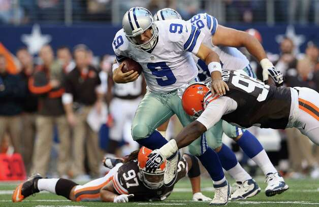 Tony Romo #9 of the Dallas Cowboys runs the ball against the Cleveland Browns at Cowboys Stadium on November 18, 2012 in Arlington, Texas. Photo: Ronald Martinez, Getty Images / 2012 Getty Images