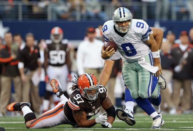 Tony Romo #9 of the Dallas Cowboys runs the ball against  Jabaal Sheard #97 of the Cleveland Browns at Cowboys Stadium on November 18, 2012 in Arlington, Texas. Photo: Ronald Martinez, Getty Images / 2012 Getty Images