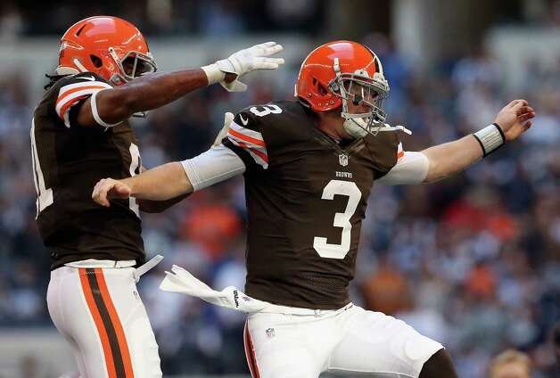 Brandon Weeden #3 of the Cleveland Browns celebrates a touchdown with  Alex Smith #81 against the Dallas Cowboys at Cowboys Stadium on November 18, 2012 in Arlington, Texas. Photo: Ronald Martinez, Getty Images / 2012 Getty Images