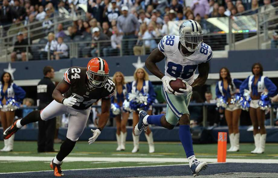 Dez Bryant #88 of the Dallas Cowboys makes a touchdown pass reception against  Sheldon Brown #24 of the Cleveland Browns at Cowboys Stadium on November 18, 2012 in Arlington, Texas. Photo: Ronald Martinez, Getty Images / 2012 Getty Images