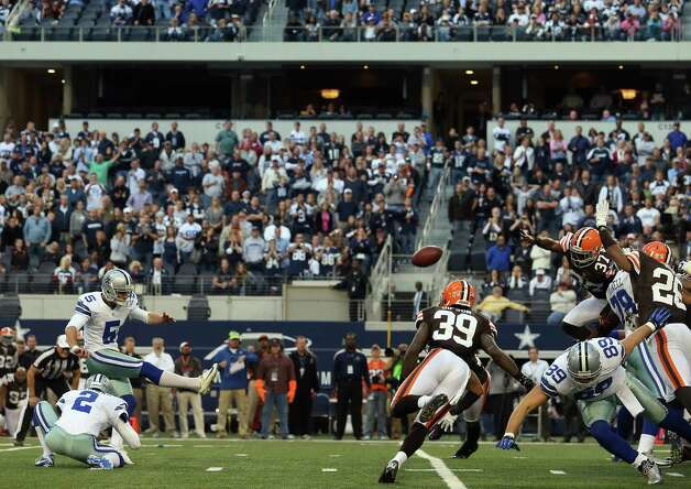 Dan Bailey #5 of the Dallas Cowboys kicks the game winning field goal against the Cleveland Browns in overtime at Cowboys Stadium on November 18, 2012 in Arlington, Texas. Photo: Ronald Martinez, Getty Images / 2012 Getty Images