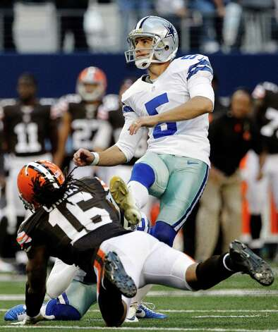 Dallas Cowboys kicker Dan Bailey (5) follows through on a field goal under pressure from Cleveland Browns wide receiver Josh Cribbs (16) late in the second half of an NFL football game, Sunday, Nov. 18, 2012, in Arlington, Texas. (AP Photo/Brandon Wade) Photo: Brandon Wade, Associated Press / FR168019 AP