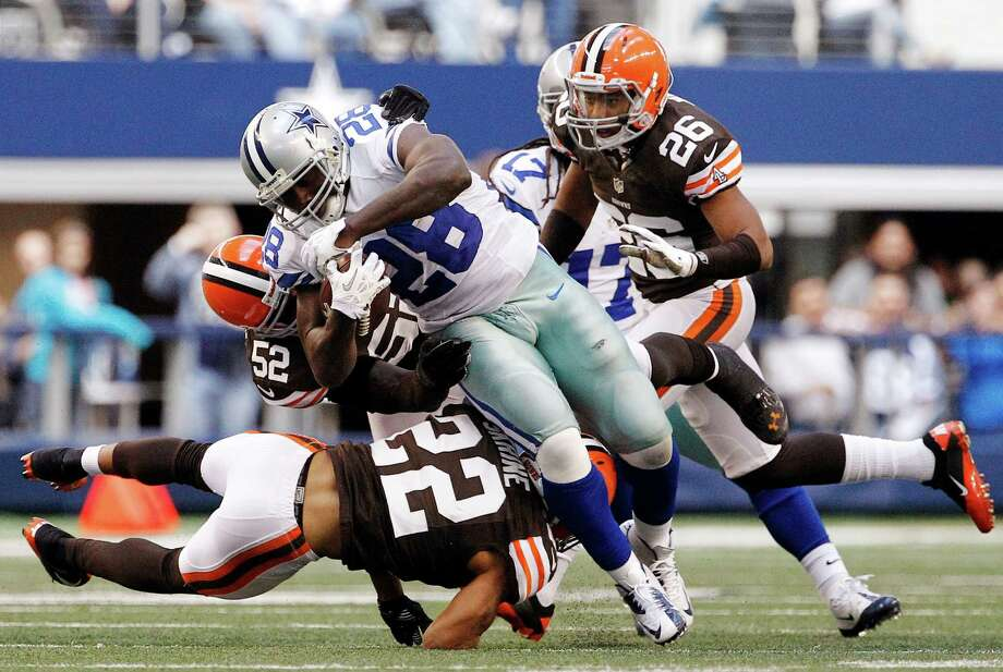 Cleveland Browns' Buster Skrine (22), D'Qwell Jackson (52) and Trevin Wade (26) combine to stop a run by Dallas Cowboys' Felix Jones in the second half of an NFL football game, Sunday, Nov. 18, 2012, in Arlington, Texas. (AP Photo/Brandon Wade) Photo: Brandon Wade, Associated Press / FR168019 AP