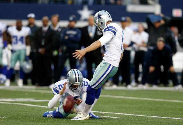 Dallas Cowboys punter Brian Moorman (2) holds as kicker Dan Bailey, right, prepares to kick a game winning field goal in overtime of an NFL football game against the Cleveland Browns Sunday, Nov. 18, 2012 in Arlington, Texas. The Cowboys won 23-20. (AP Photo/Sharon Ellman) Photo: Sharon Ellman, Associated Press / FR170032 AP