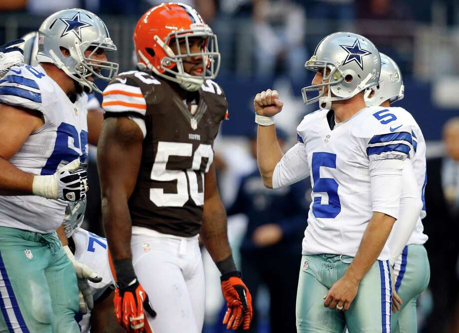 Cleveland Browns outside linebacker James-Michael Johnson (50) walks off as Dallas Cowboys tackle Doug Free, left, celebrates with Dan Bailey (5) after Bailey kicked a winning field goal in overtime of an NFL football game, Sunday, Nov. 18, 2012, in Arlington, Texas. The Cowboys won 23-20. (AP Photo/Sharon Ellman) Photo: Sharon Ellman, Associated Press / FR170032 AP