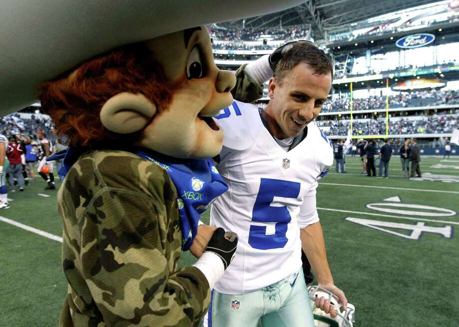 The Dallas Cowboys mascot Rowdy, left, congratulates Dan Bailey (5) on his game winning field goal against the Cleveland Browns in overtime of an NFL football game Sunday, Nov. 18, 2012 in Arlington, Texas. The Cowboys won 23-20. (AP Photo/Brandon Wade) Photo: Brandon Wade, Associated Press / FR168019 AP