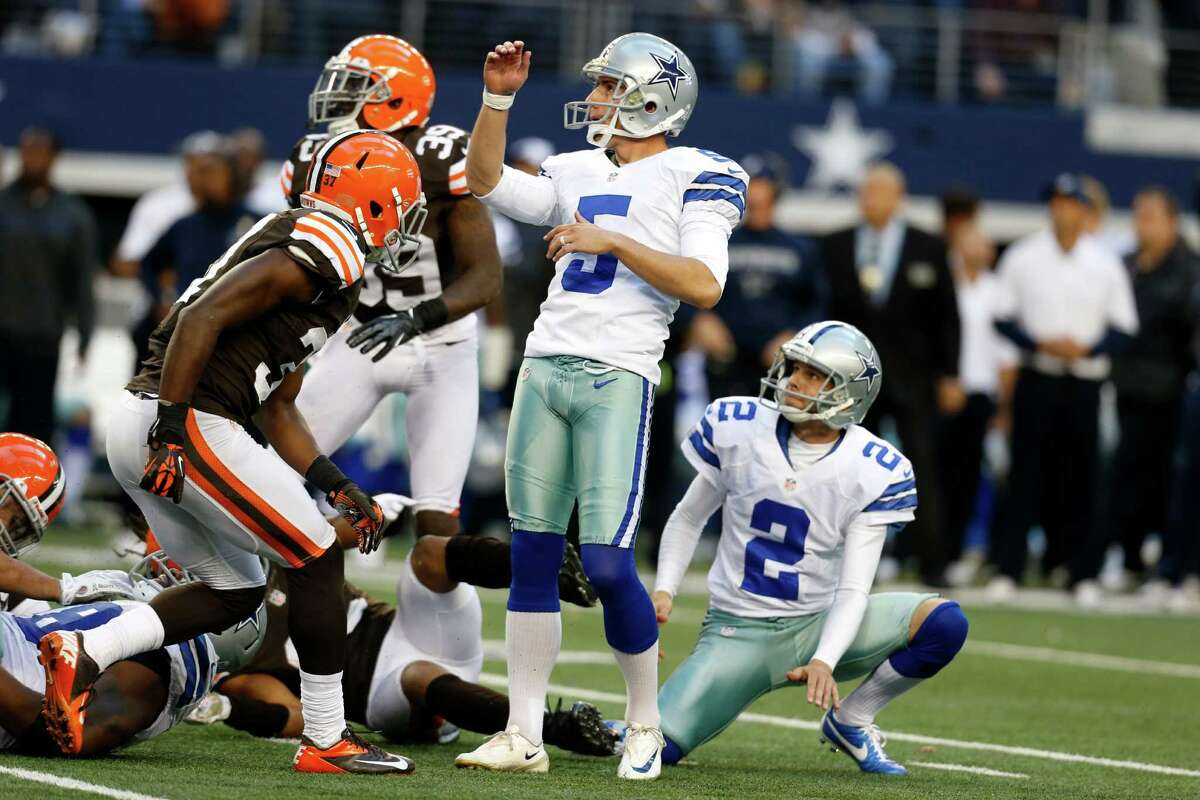 Dallas Cowboys kicker Dan Bailey (5) and Brian Moorman (2) watch as Bailey kicks a game-winning filed goal against the Cleveland Browns in overtime of an NFL football game Sunday, Nov. 18, 2012, in Arlington, Texas. The Cowboys won 23-20. (AP Photo/Sharon Ellman)