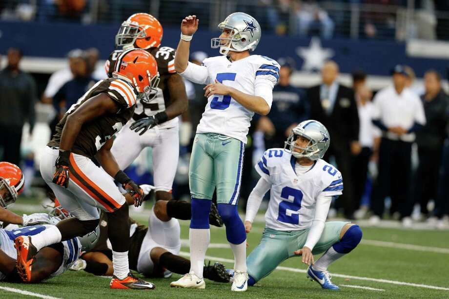 Dallas Cowboys kicker Dan Bailey (5) and Brian Moorman (2) watch as Bailey kicks a game-winning filed goal against the Cleveland Browns in overtime of an NFL football game Sunday, Nov. 18, 2012, in Arlington, Texas. The Cowboys won 23-20. (AP Photo/Sharon Ellman) Photo: Sharon Ellman, Associated Press / FR170032 AP