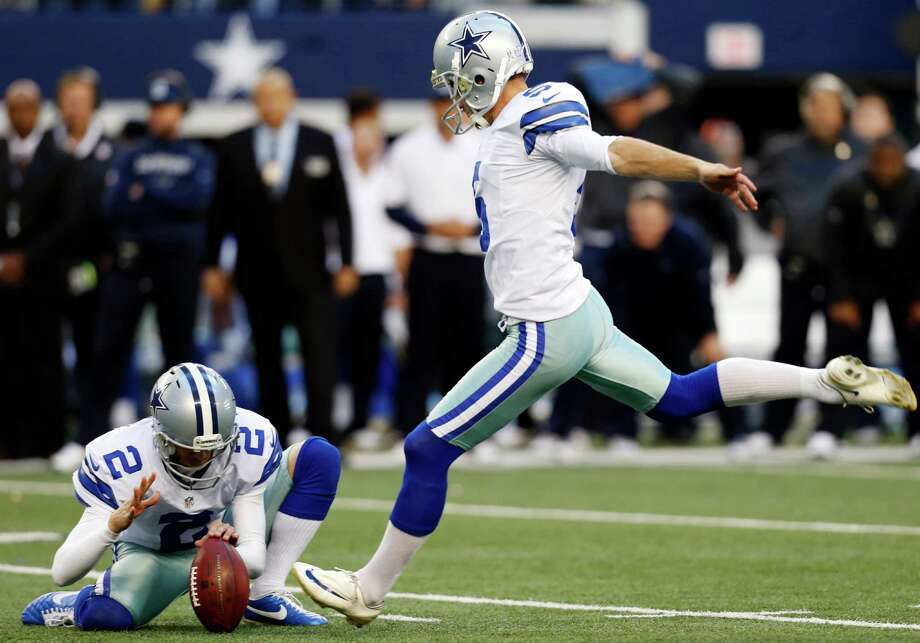 Dallas Cowboys punter Brian Moorman (2) holds as kicker Dan Bailey, right, prepares to make a winning field goal in overtime of an NFL football game against the Cleveland Browns, Sunday, Nov. 18, 2012, in Arlington, Texas. The Cowboys won 23-20. (AP Photo/Sharon Ellman) Photo: Sharon Ellman, Associated Press / FR170032 AP