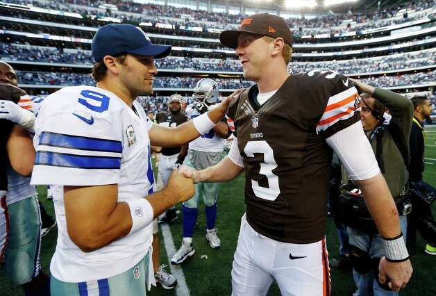 Dallas Cowboys quarterback Tony Romo (9) and Cleveland Browns quarterback Brandon Weeden (3) great each other after their NFL football game, Sunday, Nov. 18, 2012, in Arlington, Texas. The Cowboys won 23-20 in overtime. (AP Photo/Sharon Ellman) Photo: Sharon Ellman, Associated Press / FR170032 AP