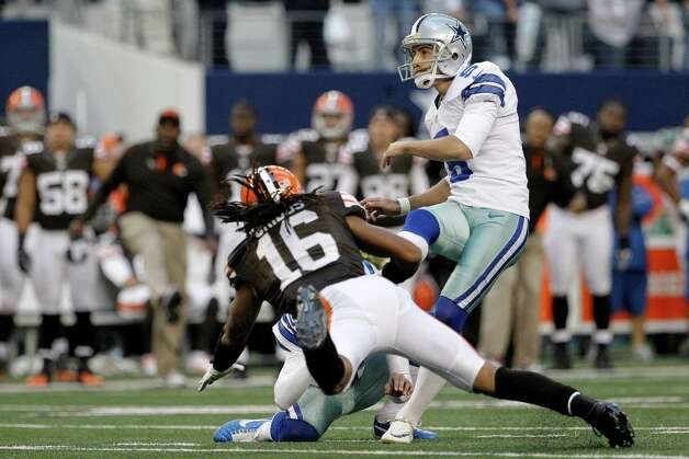 Dallas Cowboys kicker Dan Bailey (5) follows through on a field goal under pressure from Cleveland Browns wide receiver Josh Cribbs (16) late in the second half of an NFL football game Sunday, Nov. 18, 2012 in Arlington, Texas. The field goal sent the game into overtime. (AP Photo/Brandon Wade) Photo: Brandon Wade, Associated Press / FR168019 AP