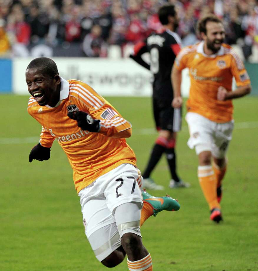 Houston Dynamo's Boniek Garcia (27) celebrates after scoring a goal against DC United during the first half of Game 2 of their MLS soccer Eastern Conference semifinal playoff match, Sunday, Nov. 18, 2012, in Washington. (AP Photo/Luis M. Alvarez) Photo: Luis M. Alvarez, Associated Press / FR596 AP