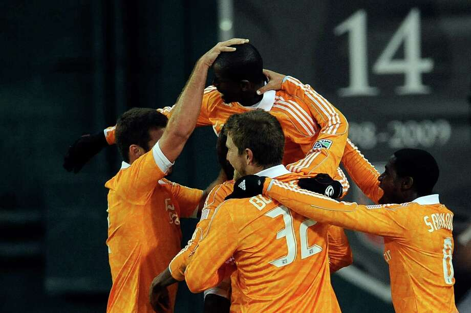 Boniek Garcia of the Dynamo celebrates after scoring a goal against D.C. United. Photo: Patrick McDermott, Getty Images / 2012 Getty Images