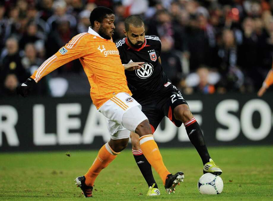 Maicon Santos of D.C. United battles for the ball against Jermaine Taylor 4 of the Dynamo. Photo: Patrick McDermott, Getty Images / 2012 Getty Images