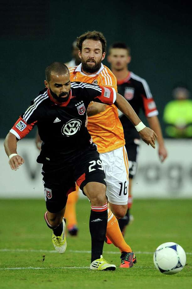 Maicon Santos of D.C. United battles for the ball against Adam Moffat of the Dynamo. Photo: Patrick McDermott, Getty Images / 2012 Getty Images