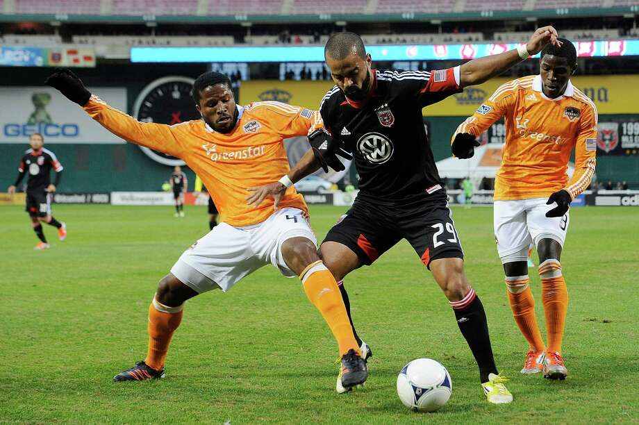 Maicon Santos of D.C. United battles for the ball against Jermaine Taylor of the Dynamo. Photo: Patrick McDermott, Getty Images / 2012 Getty Images