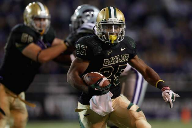 4. Baylor  (5-5, next game Saturday vs. Texas Tech) — Everybody will  talk about Phil Bennett's dramatic defensive coaching effort, but the Bears beat Kansas  State in the trenches on both sides of the ball. The Bears quietly have averaged 252.6 rushing yards and scored 16 rushing TDs in their last  five games.   (Ronald Martinez / Getty Images)