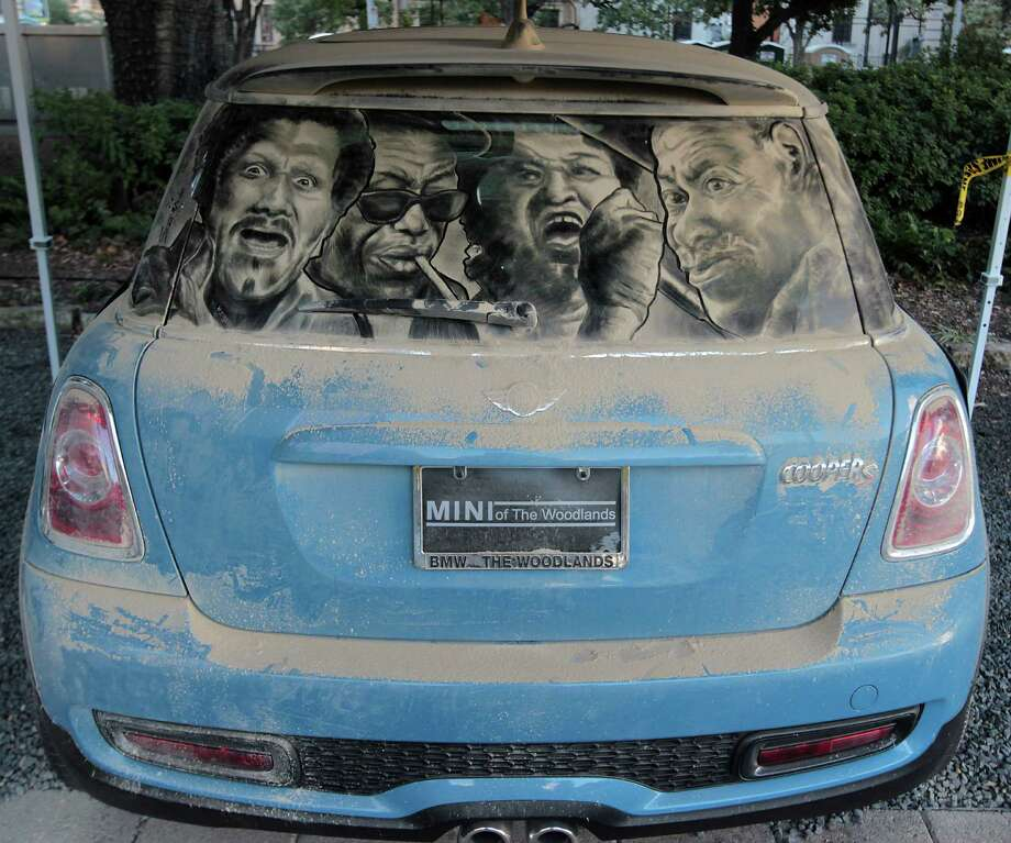 "A Dirty Car Art piece titled ""Houston Blues"" by Scott Wade during the Via Colori Street Chalk Art Festival in downtown Nov. 18, 2012, in Houston. Photo: James Nielsen, Chronicle / © Houston Chronicle 2012"