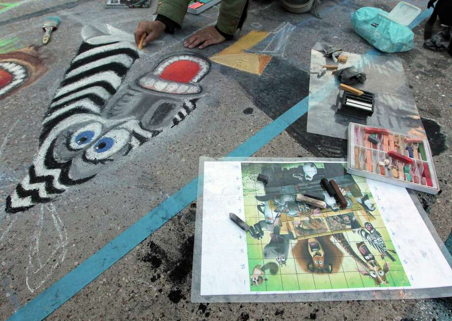 "Donna Singer works on her chalk art piece titled ""Move It Move It"" during the Via Colori street chalk art festival in downtown Nov. 18, 2012, in Houston. Photo: James Nielsen, Chronicle / © Houston Chronicle 2012"