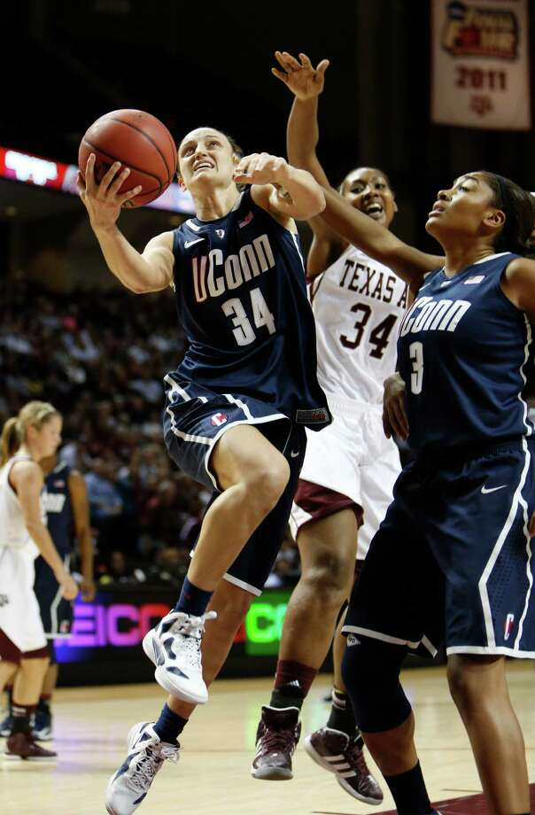 Connecticut's Kelly Faris (34) shoots the ball against Texas A&M defender Karla Gilbert (34) during the second half of an NCAA college basketball game on Sunday, Nov. 18, 2012, in College Station, Texas. Connecticut won 81-50. (AP Photo/Jon Eilts) Photo: Jon Eilts, Associated Press / FR170396 AP