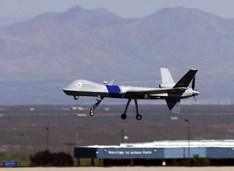The MQ-9 Predator B, an unmanned surveillance aircraft system, patrols the skies along the Mexico-Arizona border to stop illegal entry of thousands of Mexican nationals. Photo: Getty Images / 2006 Getty Images