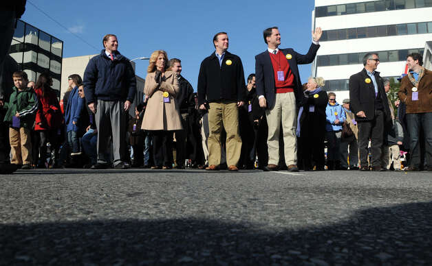 Local dignitaries including Senators Richard Blumenthal and Chris Murphy and Congressman Jim Himes, parade during the UBS Parade Spectacular in Stamford, Conn., Nov. 18, 2012. Photo: Keelin Daly / Stamford Advocate Freelance