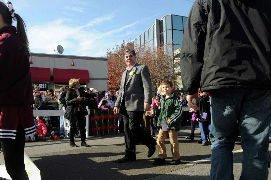 Mayor Michael Pavia and his grandson march in the UBS Parade Spectacular in Stamford, Conn., Nov. 18, 2012. Photo: Keelin Daly / Stamford Advocate Freelance