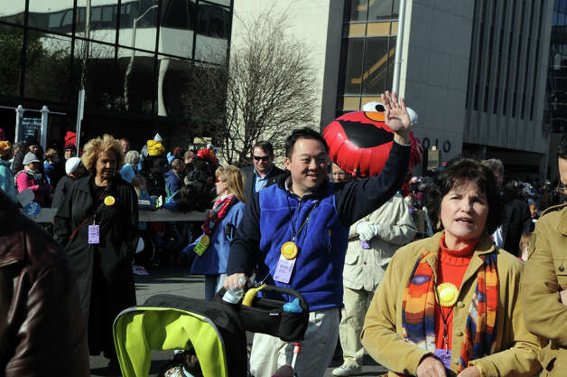 William Tong marches in the UBS Parade Spectacular in Stamford, Conn., Nov. 18, 2012. Photo: Keelin Daly / Stamford Advocate Freelance