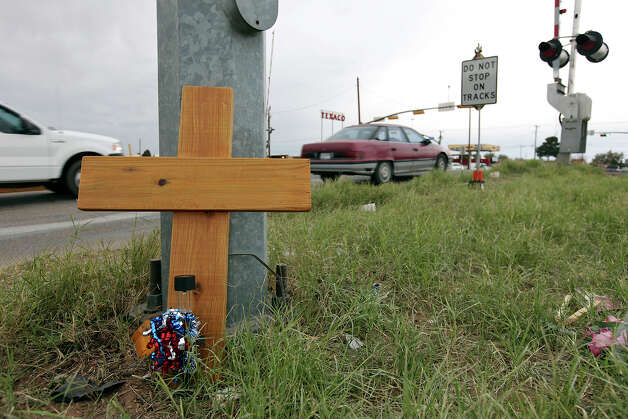 One of four crosses at the intersection, Sunday Nov. 18, 2012, in Midland, Tx., where a Union Pacific train struck a float carrying military veterans on Thursday Nov. 15, 2012, killing four men, including one from the San Antonio area. Photo: Edward A. Ornelas, San Antonio Express-News / © 2012 San Antonio Express-News