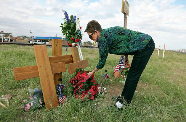 Pat Moore, 66, lays a wreath at the intersection, Sunday Nov. 18, 2012, in Midland, Tx., where a Union Pacific train struck a float carrying military veterans on Thursday Nov. 15, 2012, killing four men, including one from the San Antonio area. Photo: Edward A. Ornelas, San Antonio Express-News / © 2012 San Antonio Express-News