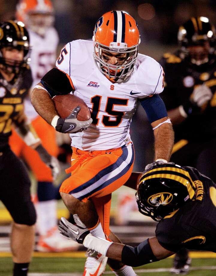 Syracuse's Alec Lemon, top, runs past Missouri's Braylon Webb, bottom, after catching a pass during the second half of an NCAA college football game, Saturday, Nov. 17, 2012, in Columbia, Mo. Lemon had 244 yards receiving and two touchdowns during the game. Syracuse won 31-27. (AP Photo/L.G. Patterson) Photo: L.G. Patterson, Wires / FR23535 AP