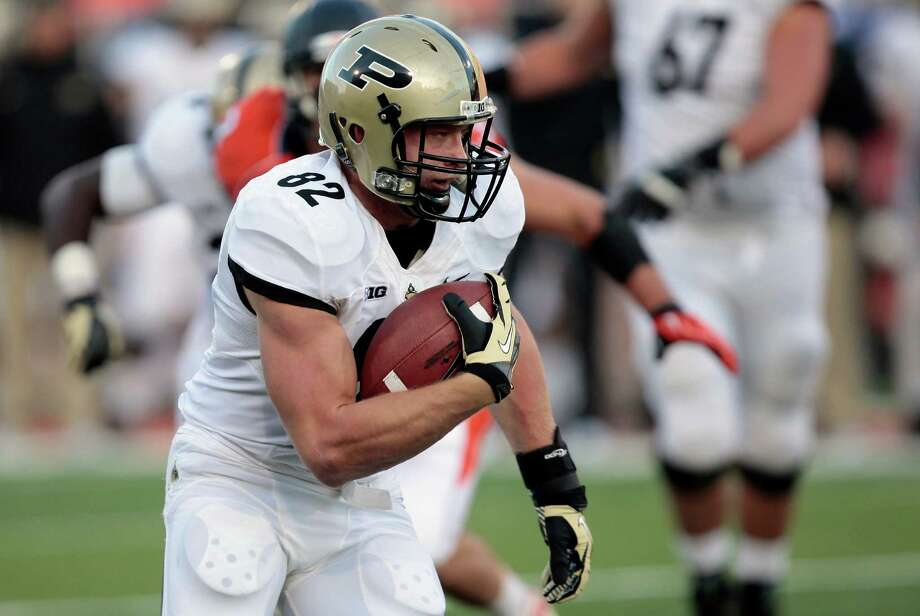 Purdue's Crosby Wright (82) runs the ball during the first half of an NCAA college football game against Illinois, Saturday, Nov. 17, 2012, in Champaign, Ill. (AP Photo/Stephen Haas) Photo: Stephen Haas, Wires / FR170194 AP