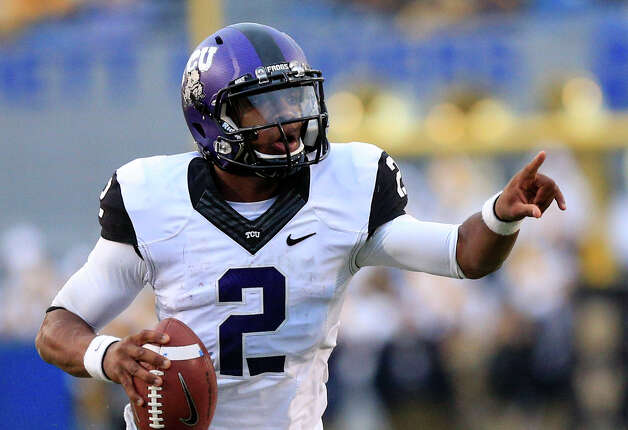 TCU's Trevone Boykin (2) scrambles from the pocket during their NCAA college football game against West Virginia in Morgantown, W.Va., on Saturday, Nov. 3, 2012. TCU won 39-38 in overtime. (AP Photo/Christopher Jackson) Photo: Christopher Jackson, Wires / FRE 170573 AP