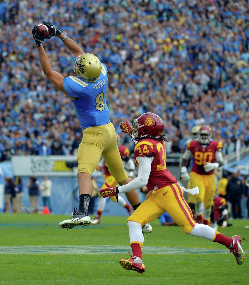 UCLA tight end Joseph Fauria makes a catch as Southern California linebacker Tony Burnett defends during the first half of their NCAA college football game, Saturday, Nov. 17, 2012, in Pasadena, Calif. (AP Photo/Mark J. Terrill) Photo: Mark J. Terrill, Wires / AP