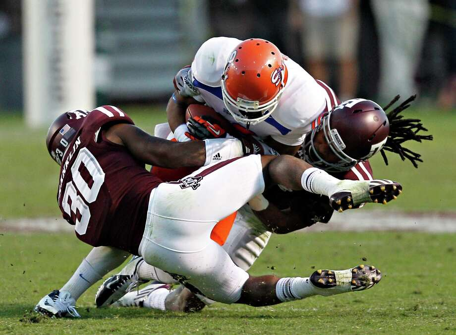 COLLEGE STATION, TX - NOVEMBER 17: Rickey Smith #16 of the Sam Houston State Bearkats is hit by Johntel Franklin #30 of the Texas A&M Aggies at Kyle Field on November 17, 2012 in College Station, Texas. (Photo by Bob Levey/Getty Images) Photo: Bob Levey, Wires / 2012 Getty Images