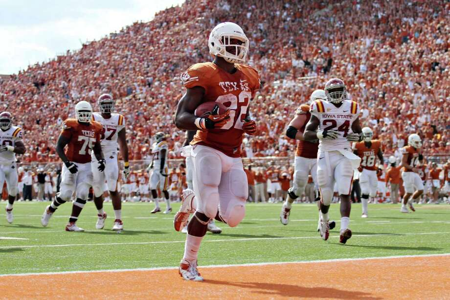 Texas running back Johnathan Gray scores a touchdown against Iowa State during the fourth quarter of an NCAA football game, Saturday, Nov. 10, 2012, in Austin Texas. (AP Photo/The Daily Texan, Marisa Vasquez) Photo: Marisa Vasquez, Wires / The Daily Texan