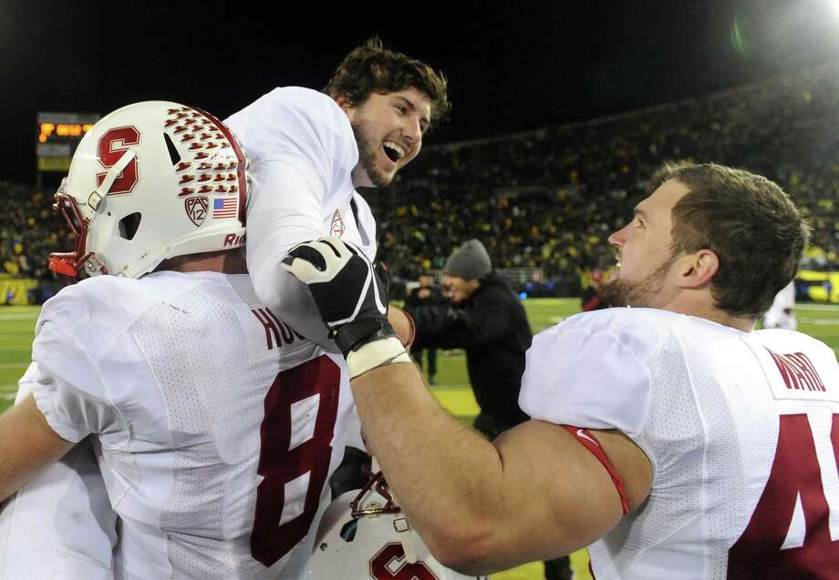 EUGENE, OR - NOVEMBER 17: Kicker Jordan Williamson #19 is lifted up by quarterback Kevin Hogan #8 and congratulated by fullback Lee Ward #46 of the Stanford Cardinal after kicking the winning field goal of the game against the Oregon Ducks at Autzen Stadium on November 17, 2012 in Eugene, Oregon. Stanford won the game 17-14 in overtime. (Photo by Steve Dykes/Getty Images) Photo: Steve Dykes, Wires / 2012 Getty Images