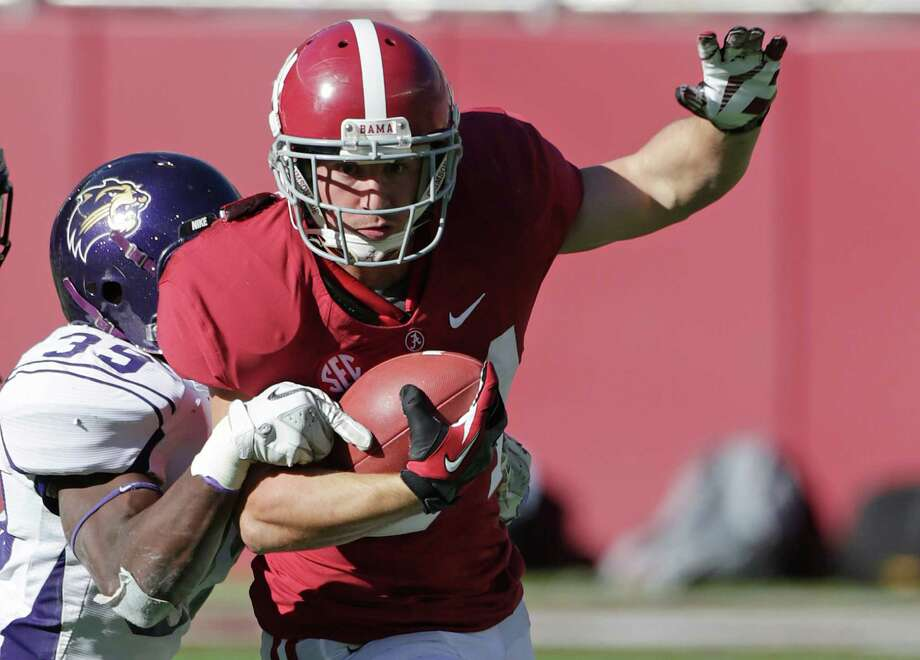 Alabama running back Ben Howell (34) is stopped by Western Carolina defensive back Sertonuse Harris (39) during the second half of an NCAA college football game at Bryant-Denny Stadium in Tuscaloosa, Ala., Saturday, Nov. 17, 2012. Alabama won 49-0. (AP Photo/Dave Martin) Photo: Dave Martin, Wires / AP