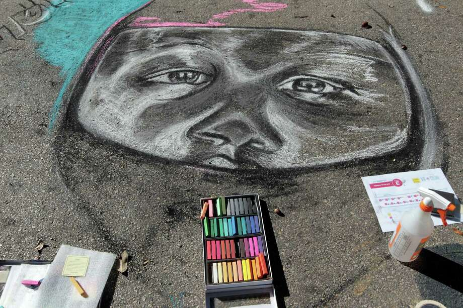 A chalk art piece during the Via Colori Street Chalk Art Festival in downtown Nov. 18, 2012, in Houston. Photo: James Nielsen, Chronicle / © Houston Chronicle 2012