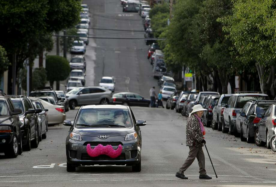 Cars with Zimride's ride-share app service, Lyft, display a distinctive pink mustache. Photo: Michael Macor, The Chronicle