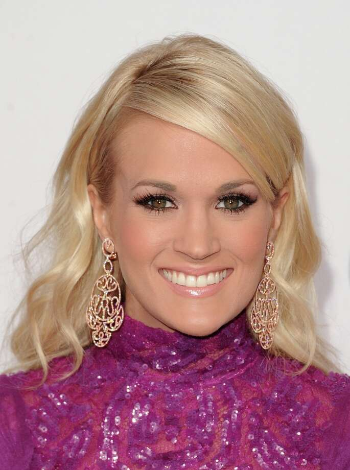 The stars  — from Taylor Swift and Carrie Underwood to Chris Brown and Pink to a newly single Justin Bieber and his mom — walked the red carpet at the American Music Awards. Short minis flashing lots of leg and gold and yellow dresses are some of the looks that dominated. Take at peek.  Here, singer Carrie Underwood attends the 40th American Music Awards held at Nokia Theatre L.A. Live on November 18, 2012 in Los Angeles, California.  (Photo by Jason Merritt/Getty Images) Photo: Jason Merritt, Getty Images / 2012 Getty Images
