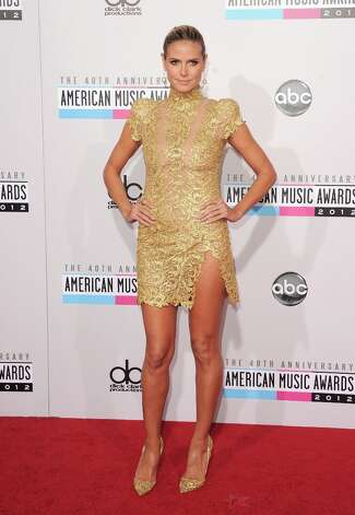 TV personality Heidi Klum attends the 40th American Music Awards held at Nokia Theatre L.A. Live on November 18, 2012 in Los Angeles, California.  (Photo by Jason Merritt/Getty Images) Photo: Jason Merritt, Getty Images / 2012 Getty Images