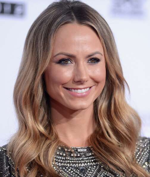 Actress Stacy Keibler attends the 40th American Music Awards held at Nokia Theatre L.A. Live on Nove